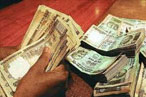 Rupee weak by 17 paise