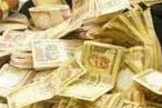 Rupee edges up