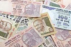 Rupee at near 6-month low