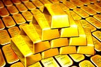 Gold weighed down by strong dollar