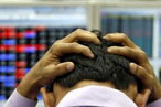 Sensex ends off days low