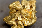 Gold slips in red as $1200 eludes, traders grow cautious about Swiss Gold initiative