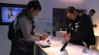 Smartphone giants unveil latest models at technology show