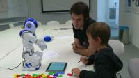 Children learn to write by teaching robots