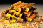 Gold trades above 25k, down Rs 457