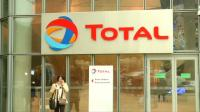 Cost cuts help Total beat low oil prices
