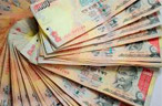 Rupee ends near 2-week high