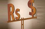 Rupee ends at days low