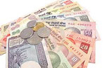 Rupee rebounds, up 10 paise